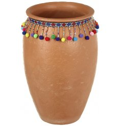 this tall terracotta pot will be sure to look perfect in any home interior or garden display this summer