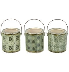 Set a trending touch in any home space or garden environment with this sleek assortment of distressed inspired pots