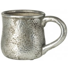 This stone mug decoration will be sure to bring a Luxe Charm to any home interior or display