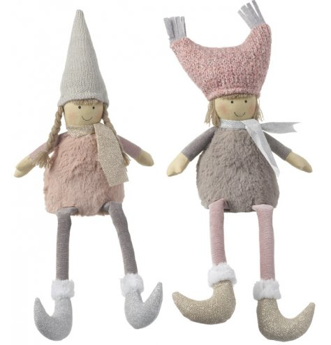 Pretty pink nordic children shelf sitters wearing knitted Christmas hats and faux fur trimmed glitter boots.