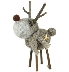 Bring a sweet and charming little touch to any home decor or display with this grey woollen reindeer figure