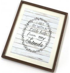 A wooden frame with Help From My Friends quote