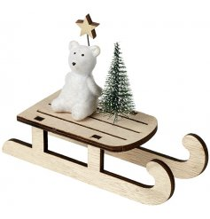 A sweet little resin bear perched on a wooden sleigh, a perfect home decoration for the festive season!