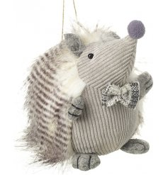 With his fuzzy prickles and sweet tweed bowtie, this grey little hedgehog will be sure to add a cute edge to any set up