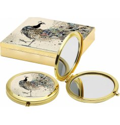 A beautiful golden toned compact mirror, perfectly finished with an illustrated peacock design
