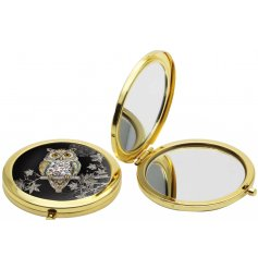 A beautiful golden toned compact mirror, perfectly finished with an illustrated wise old owl design