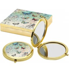 A beautiful golden toned compact mirror, perfectly finished with an illustrated butterfly design