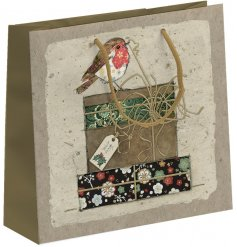 A pretty floral themed gift bag set with an added Robin decal