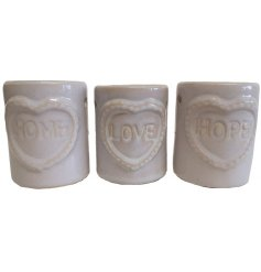 Produce a cozy glow and a romantic sense to your home spaces with this chic assortment of pillar ceramic oil burners