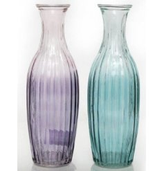 Bring a fresh Spring feel to your home decor or interiors with this assortment of toned glass vase decorations