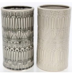 Bring a Pure and Warm sense to any home space or display with this charming assortment of glazed ceramic vases
