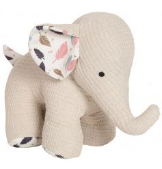 A small beige Elephant Doorstop with feather print