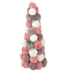 Add a charming and ontrend twist to your Christmas decor this year with this beautiful pompom tree