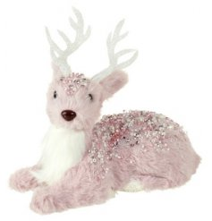 this laying reindeer figure will add a sweet and chic touch to any home decor this festive season