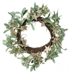 this round wreath built up with mistletoe will be sure to bring a romantic charm into any home