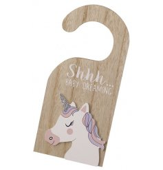 A sweet little natural wooden hanger, complete with a scripted quote and little unicorn decal