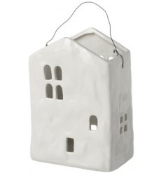A charming little ceramic tlight holder set in a house form