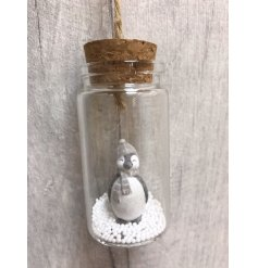 An assortment of 3 adorable glitter penguins sat within snow filled jars. Complete with jute string to hang.