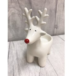 A mix of 2 white t-light holders in a reindeer design. Each has a festive red nose, adding character and charm