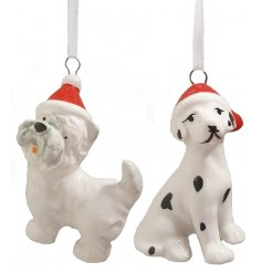 A mix of 4 cute ceramic dog ornaments, each with a red Christmas hat.
