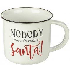 Enjoy a warming drink this season in this gorgeous Santa design slogan mug.