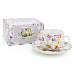 A cup and saucer with Pink Daisy Print