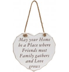 A heart hanging plaque with Friends Family Love Grows quote