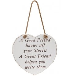 A heart hanging plaque with a good friend knows all your stories quote
