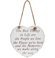 A heart shaped hanging plaque with the best things in live sentimental quote