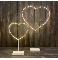A shabby chic standing heart decoration with warm glow LED lights.