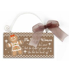 A humorous gingerbread woman slogan sign with wire handle and an organza bow.