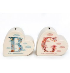 A beautifully charming assortment of ceramic money boxes covered with a sweet baby blue and pretty pink illustrated des