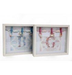 An assortment of 2 Baby Balloon Peg Photo Frames