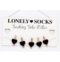 This quirky wooden hanging plaque will be sure to help find all your lost sockies from the laundry pile!