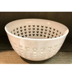 Bring a charming simple touch to your kitchenwares with this sleek white toned bowl with an added cut out heart decal