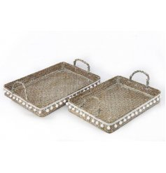 A beautiful set of natural woven sized trays with an added white wash effect and hanging pompom decals