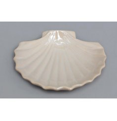 A Cream glazed trinket Dish in the shape of a clam shell