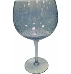 A gorgeous, long stemmed Gin Glass featuring a charming blue tint and an added dewdrop decal