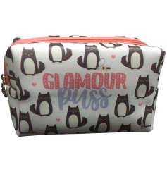 Keep a hold of all your favorite makeup items in one safe place when travelling with this quirky 'Glamour Puss' bag