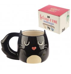 With its bushy black tail handle and added heart button nose, this fabulous feline themed mug is a must have!
