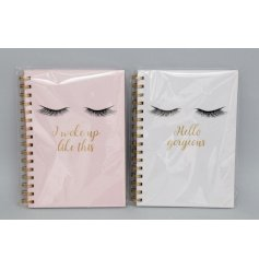 An assortment of 2 A5 notebooks with a glamorous eyelash design and beauty slogans.