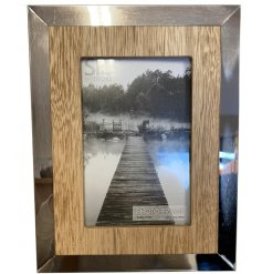 A chic natural wooden picture frame complete with a silver mirrored edge effect, a perfect home accessory for any themed
