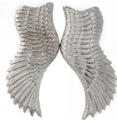 A pair of silver angel wings. A beautiful decorative accessory for the home.