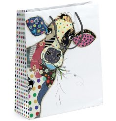 A large Bug Art Connie Cow Gift Bag