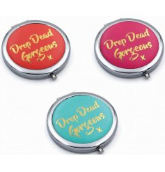 "Stylish assortment of Pink, Blue and Red toned compact mirrors, each complete with a golden ""Drop Dead Gorgeous x"" text"