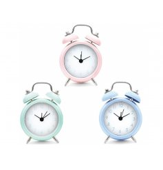 A stylish assortment of mini alarm clocks set in a pastel blue, pink and green tone.