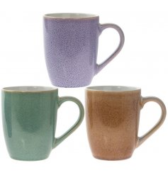 Bring a splash of colour to your kitchen interior with this stylish assortment of Earthenware inspired mugs
