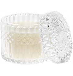 A beautifully patterned glass candle pot with a crystal inspired embellishment and 'mandarin blush' scented wax centre