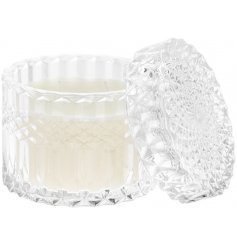 A beautifully patterned glass candle pot with a crystal inspired embellishment and 'Vanilla Honey' scented wax centre