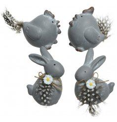 rustic finished terracotta bunnies and chickens, set with daisies and feather decals